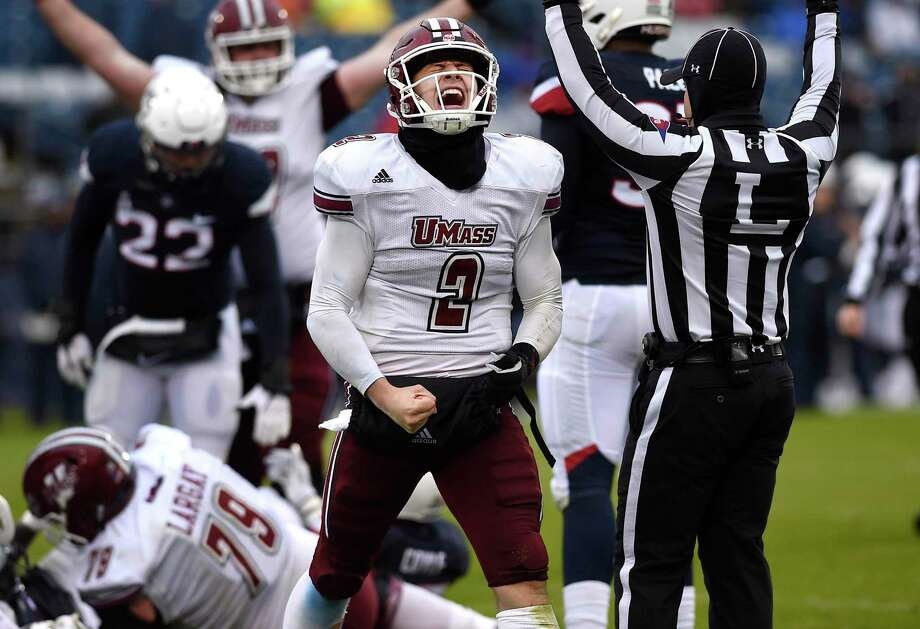 UMass quarterback Ross Comis (2) celebrates a touchdown by teammate Marquis Young in the fourth quarter at UConn on Oct. 27, 2018, in East Hartford. Photo: Jessica Hill / Associated Press / Copyright 2018 The Associated Press. All rights reserved
