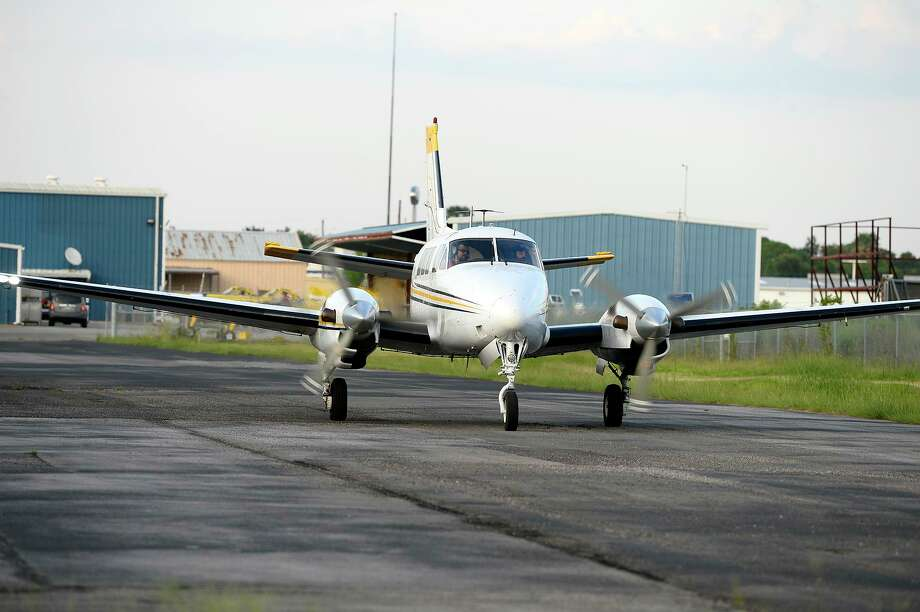 The Jefferson County Mosquito Control District's King Air 90 taxis to the runway at Jack Brooks Regional Airport on Monday evening. The county operates three planes to spray for mosquitoes.   Photo taken Monday 9/17/18  Ryan Pelham/The Enterprise Photo: Ryan Pelham / Ryan Pelham/The Enterprise / ©2018 The Beaumont Enterprise