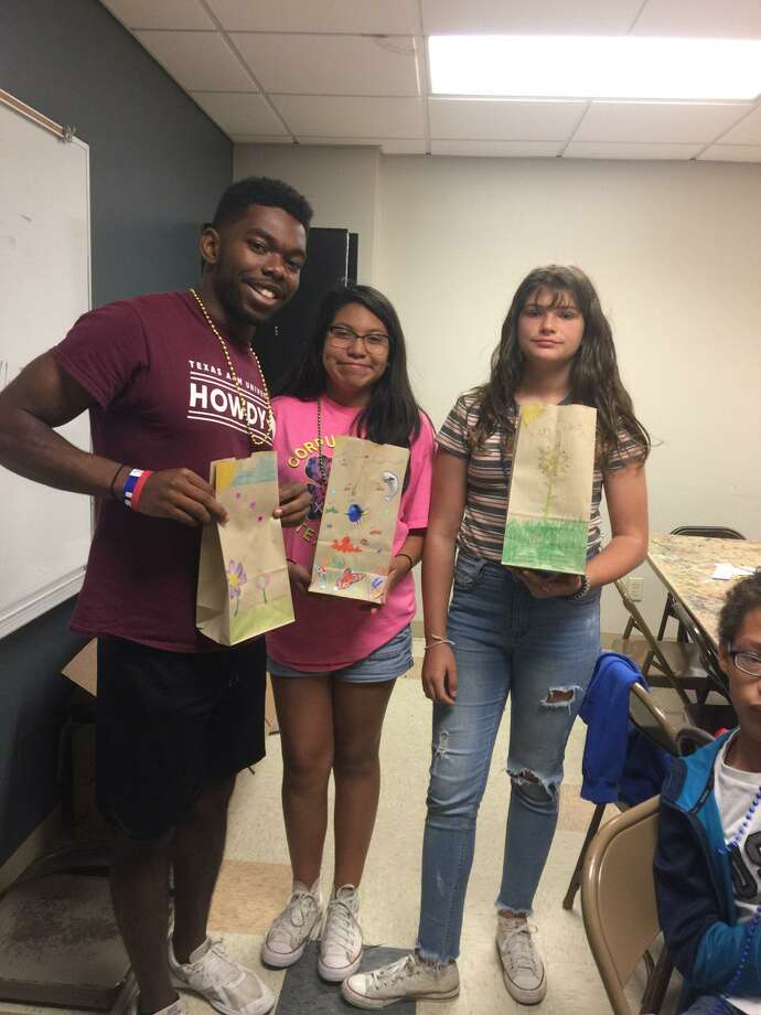"""Participants of the city of Conroe's """"Totally Teen"""" program participated in packing craft kits for Texas Children's Hospital in The Woodlands this week. Photo: Courtesy Photo"""