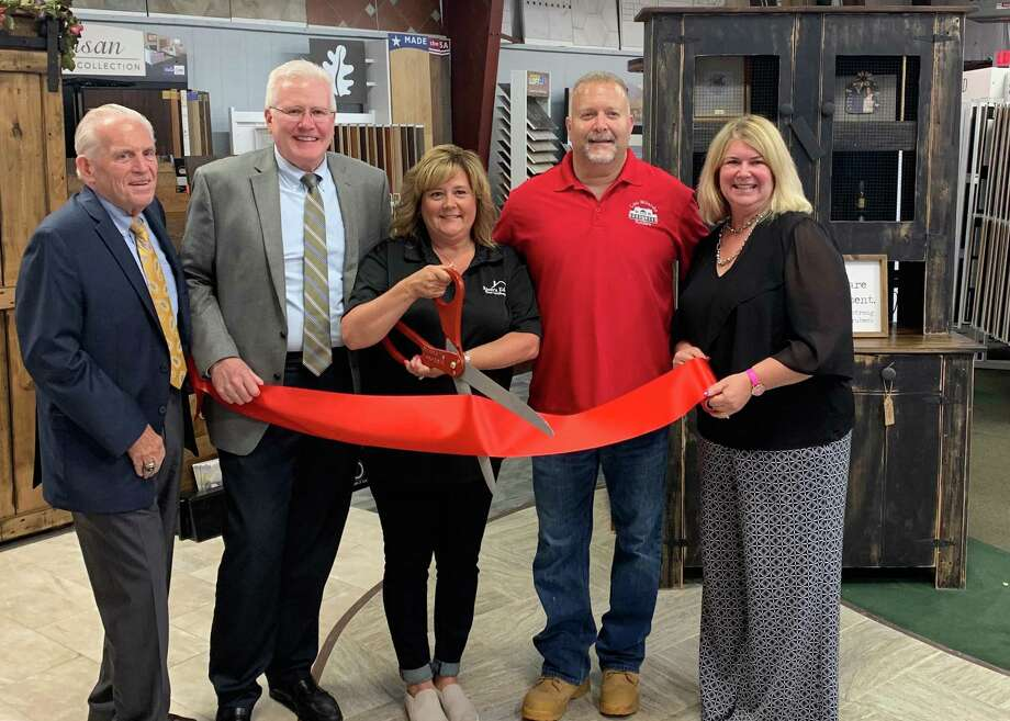 River's Edge Home Center at 100 Bridge Road in Haddam held a grand reopening June 25. From left are Middlesex County Chamber of Commerce President Larry McHugh, Middlesex County Revitalization Fund Chairman and Middlefield First Selectman Ed Bailey, River's Edge owners Gianna and Lou Milardo and First Selectwoman Lizz Milardo. Photo: Contributed Photo