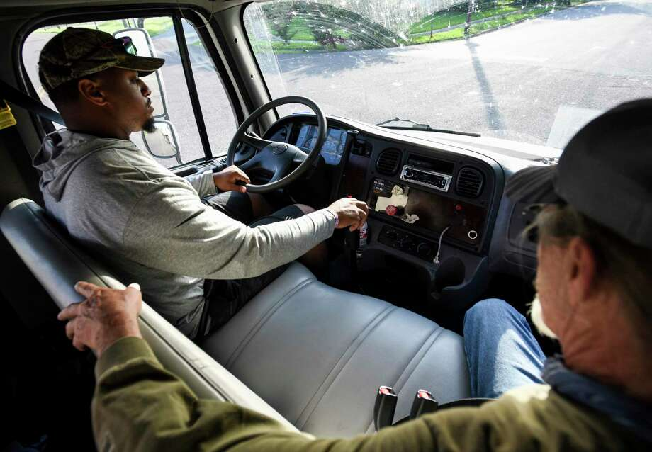Matthew Romar drives a truck while instructor Ken Davis watches during the CDL training in one of Lamar State College Port Arthur's parking lots which involved both pre-checking the trucks and driving them. Photo taken on Tuesday, 06/11/19. Ryan Welch/The Enterprise Photo: Ryan Welch, Beuamont Enterprise / The Enterprise / © 2019 Beaumont Enterprise
