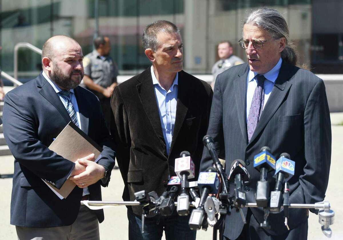 Fotis Dulos, center, is accompanied by his attorneys Rich Rochlin, left, and Norm Pattis after making an appearance at Connecticut Superior Court in Stamford, Conn. Wednesday, June 26, 2019. Fotis Dulos appeared with his attorneys, Norm Pattis and Rich Rochlin, for a hearing Wednesday on motion by a divorce attorney for Jennifer Dulos to have Fotis Dulos and his attorneys held in contempt and for the court to impose sanctions for violating a judge's order that sealed a custody and psychological evaluation conducted on the Dulos family.