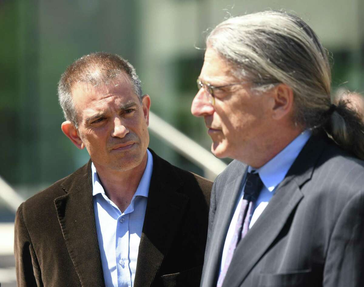Fotis Dulos, left, is accompanied by his attorney Norm Pattis, after making an appearance at Connecticut Superior Court in Stamford, Conn. Wednesday, June 26, 2019. Fotis Dulos appeared with his attorneys, Norm Pattis and Rich Rochlin, for a hearing Wednesday on motion by a divorce attorney for Jennifer Dulos to have Fotis Dulos and his attorneys held in contempt and for the court to impose sanctions for violating a judge's order that sealed a custody and psychological evaluation conducted on the Dulos family.