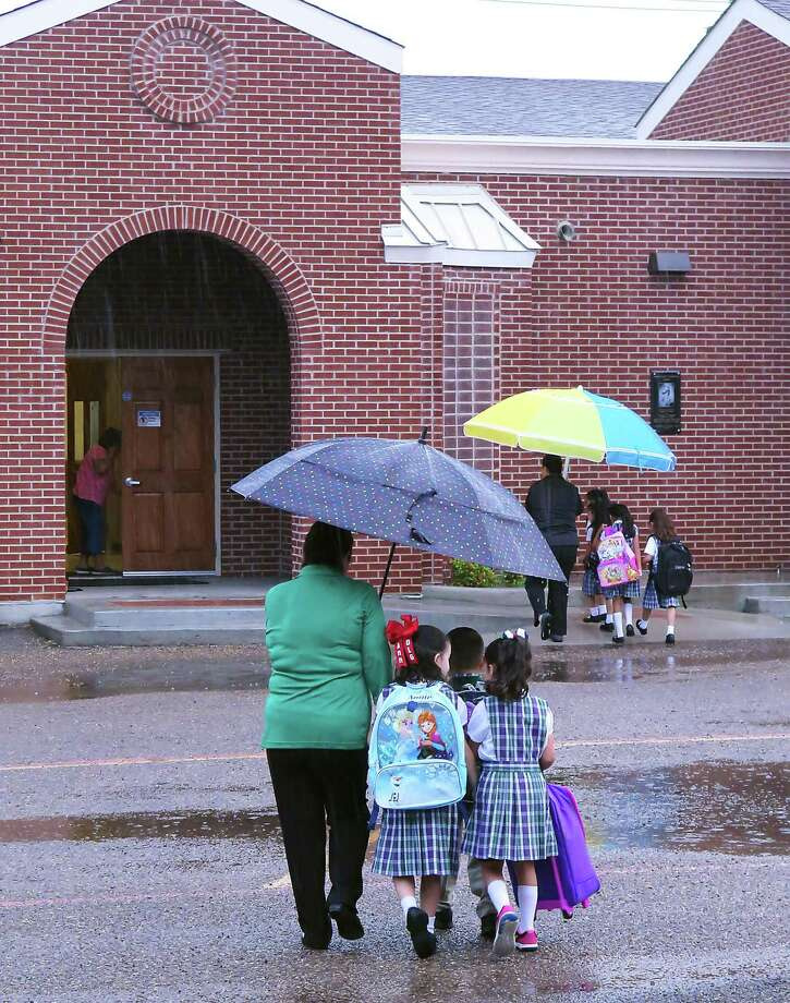 Students at Our Lady of Guadalupe Catholic School are escorted to their classroooms Monday morning. Photo: Cuate Santos / Laredo Morning Times