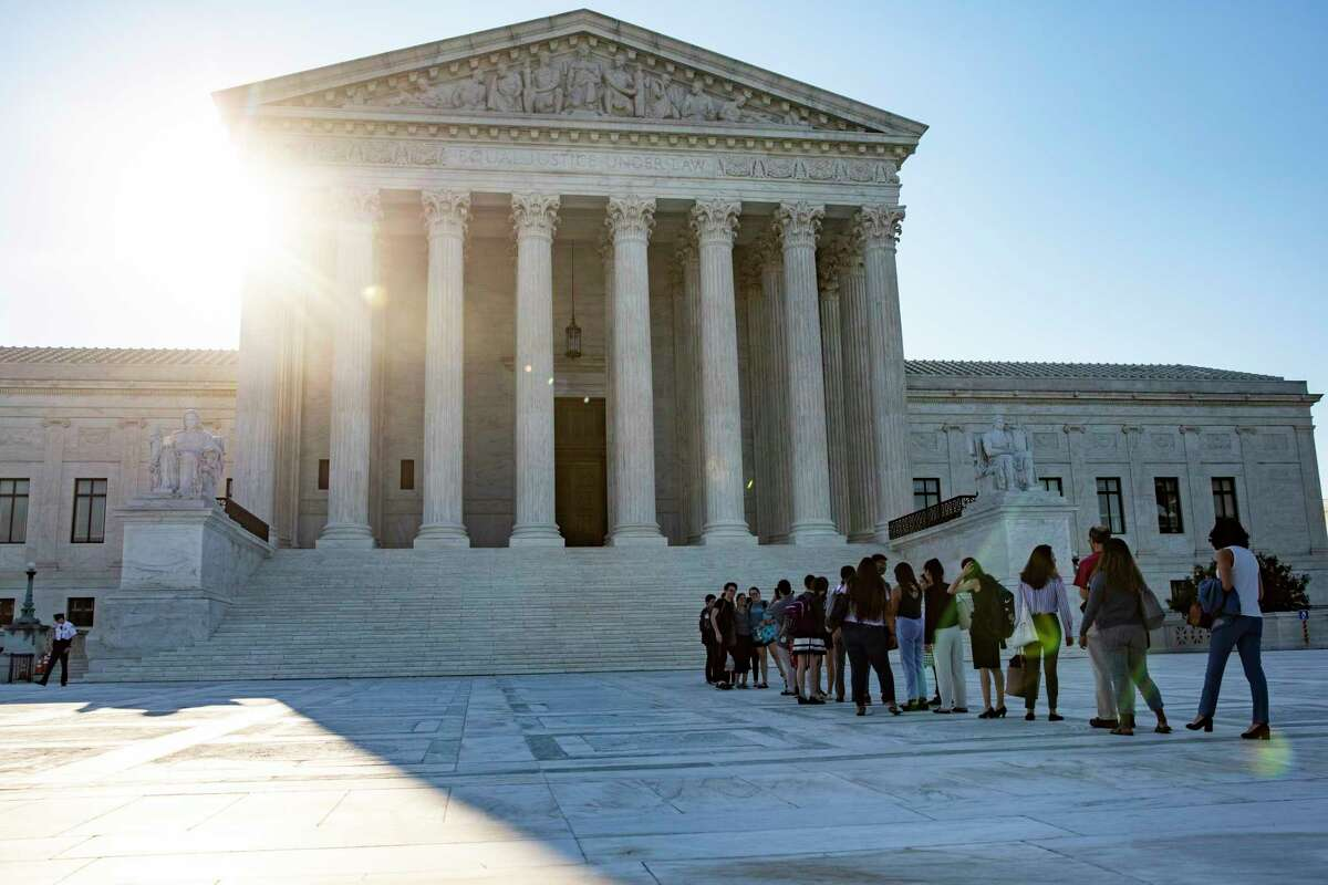 People line up early to be allowed into the Supreme Court building in Washington, June 27, 2019. The Supreme Court on Thursday ruled against the challengers opposed to partisan gerrymandering, the practice in which the party that controls the state legislature draws voting maps to help elect its candidates. (Samuel Corum/The New York Times)