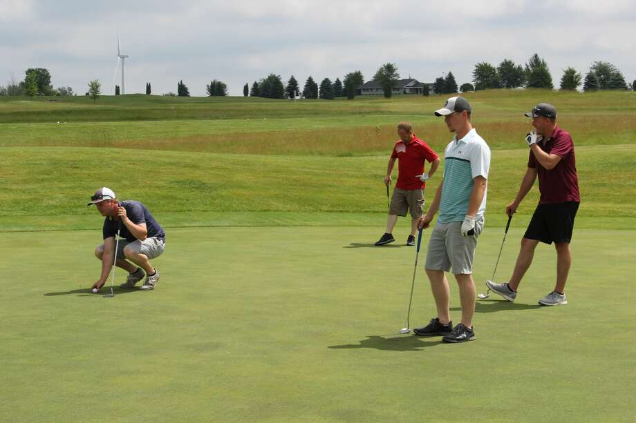 Golfers take part in the first Huron Daily Tribune Golf Benefit at Ubly Heights Golf-County Club. Proceeds will benefit Huron County Care and Share. Photo: Robert Creenan/Huron Daily Tribune