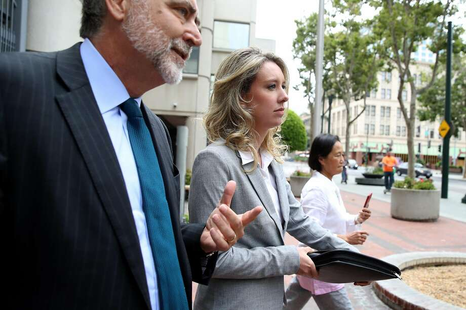 Former Theranos founder and CEO Elizabeth Holmes (C) leaves the Robert F. Peckham U.S. Federal Court on June 28, 2019 in San Jose, California. Former Theranos CEO Elizabeth Holmes and former COO Ramesh Balwani appeared in federal court for a status hearing. Both are facing charges of conspiracy and wire fraud for allegedly engaging in a multimillion-dollar scheme to defraud investors with the Theranos blood testing lab services. Photo: Justin Sullivan / Getty Images 2019