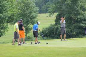 Golfers take part in the first Huron Daily Tribune Golf Benefit at Ubly Heights Golf-County Club. Proceeds will benefit Huron County Care and Share.
