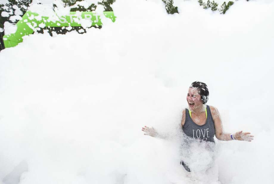 Lesley McCracken finishes the 2019 Snow Run at Lumberton's City Park Saturday morning. Around 30 people took part in the 5k race. Photo taken on Saturday, 6/29/19. Ryan Welch/The Enterprise Photo: Ryan Welch/The Enterprise
