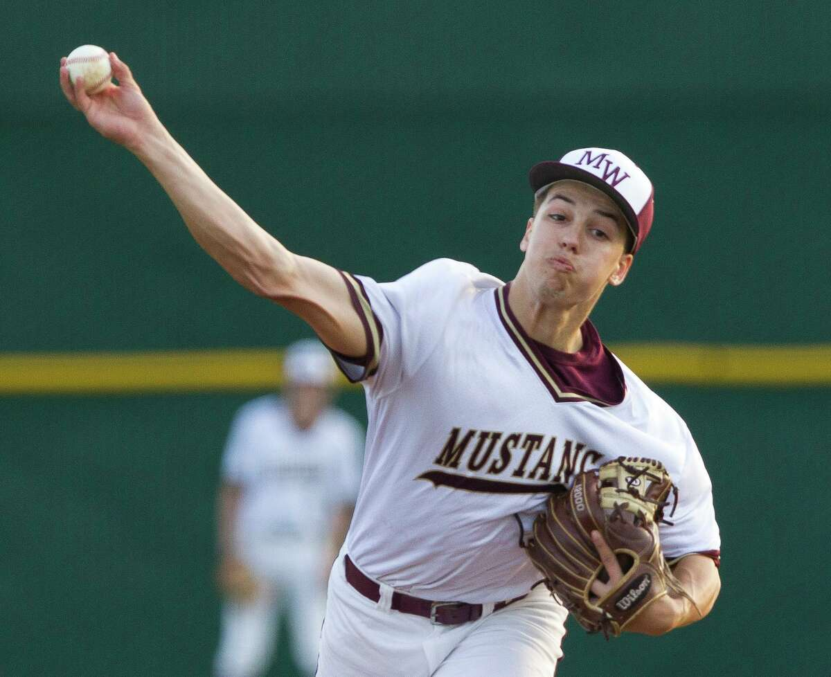 Magnolia West starting pitcher Connor Phillips (9) throws during the first inning of a District 19-5A high school baseball game at Magnolia West High School, Tuesday, April 16, 2019, in Magnolia.