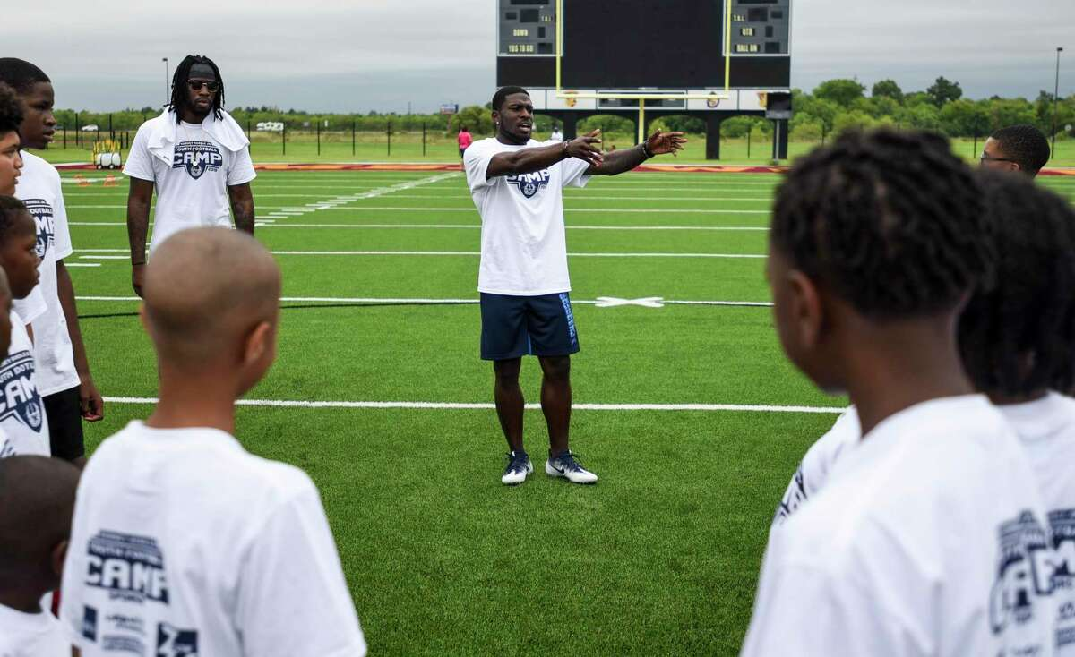 Rodney Randle Jr. talks to the kids at his youth football camp at Beaumont ISD Memorial stadium Saturday. Photo taken on Saturday, 6/29/19. Ryan Welch/The Enterprise