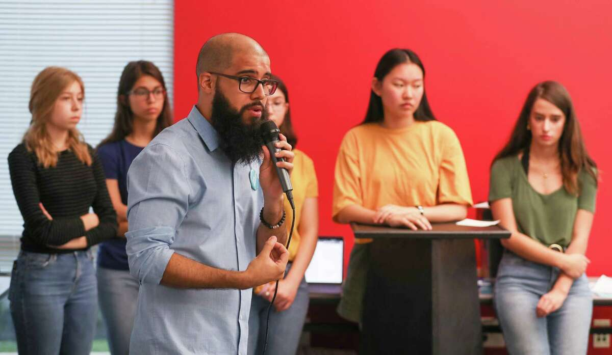 Stevens Orozco, educator, politician and current candidate for Congress District 18, speaks to the national Sunrise Movement, youth from across Houston during a town hall to raise awareness and support for a Green New Deal Saturday, June 29, 2019, in Houston.