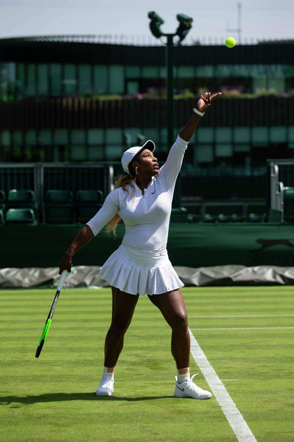 Serena Williams of USA serves during a training session at the All England Lawn Tennis Championships in Wimbledon, London, on Friday, June 28, 2019. The Wimbledon Tennis Championships 2019 will be held in London from July 1 to July 14. (Peter Klaunzer/Keystone via AP)