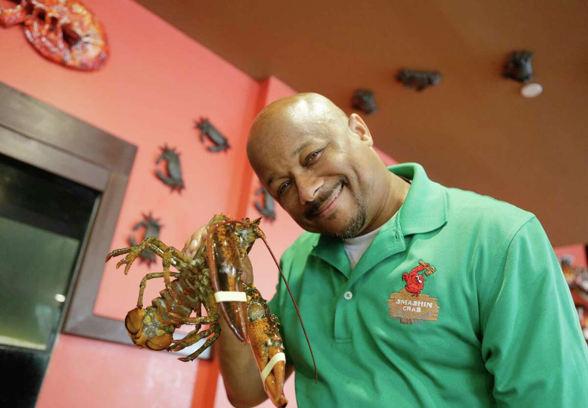 Paul Griffith, co-owner and president of the Smashin Crab, holds up a lobster. The restaurant has two locations in San Antonio.