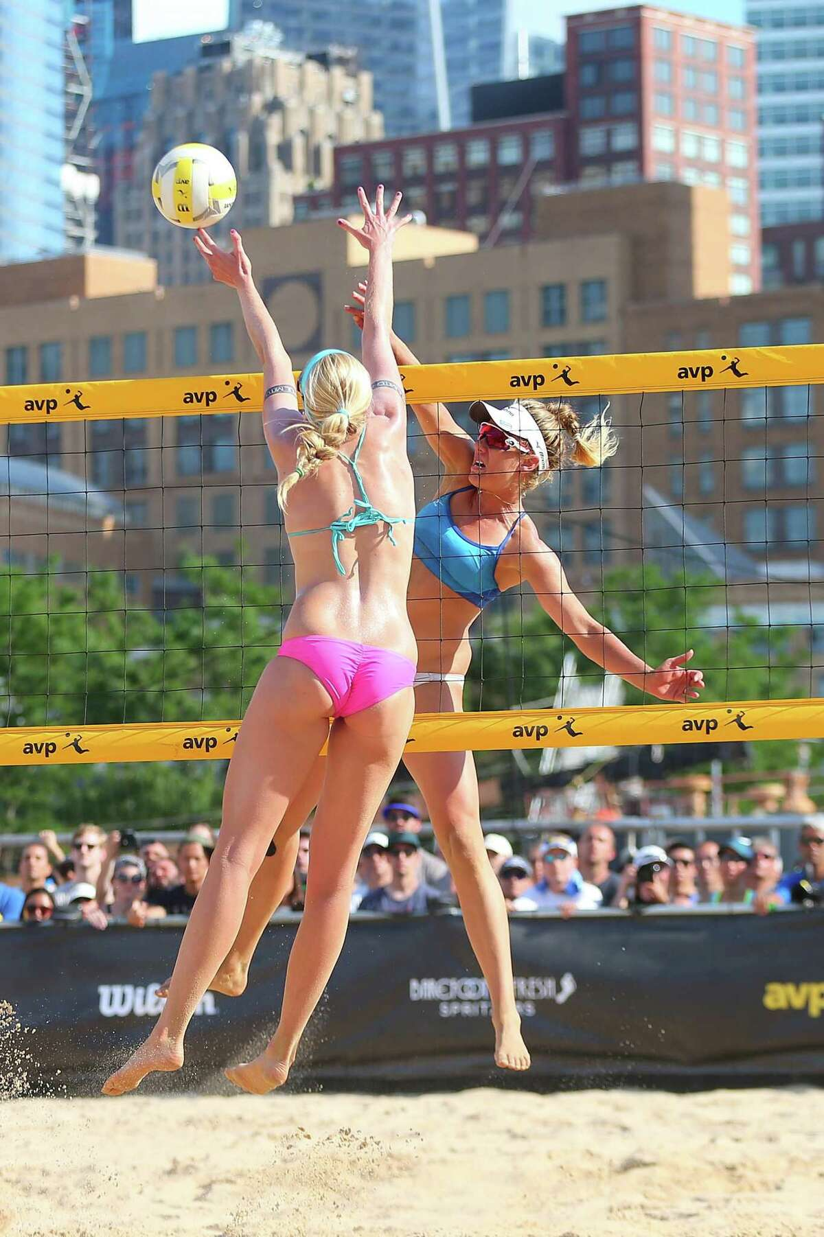 NEW YORK, NY - JUNE 19: April Ross spikes the ball against Summer Ross during the Women's AVP New York Open Championship Match at Hudson River Park on June 19, 2016 in New York City. (Photo by Mike Stobe/Getty Images) ORG XMIT: 624863025