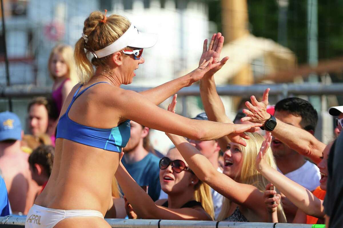 NEW YORK, NY - JUNE 19: April Ross celebrates after defeating Lane Carico and Summer Ross to win the Women's AVP New York Open Championship Match at Hudson River Park on June 19, 2016 in New York City. (Photo by Mike Stobe/Getty Images) ORG XMIT: 624863025