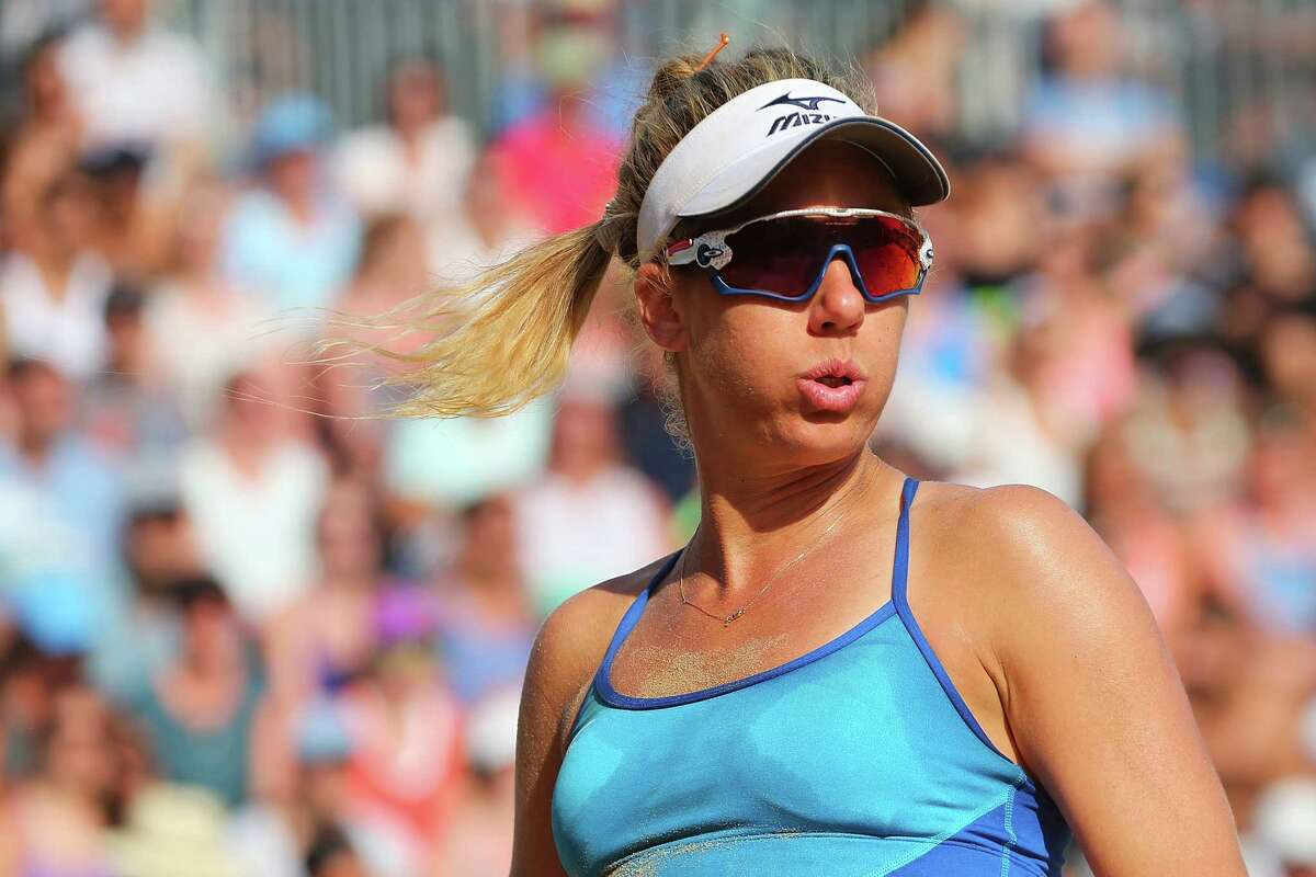 NEW YORK, NY - JUNE 19: April Ross looks on against Lane Carico and Summer Ross during the Women's AVP New York Open Championship Match at Hudson River Park on June 19, 2016 in New York City. (Photo by Mike Stobe/Getty Images) ORG XMIT: 624863025