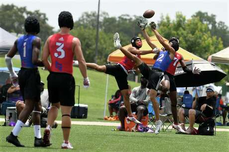 Katy defenders Ronnie Schneider, center, and Hunter Washington (7) team up to deflect a ball from DeSoto receiver Lawrence Arnold during their Division I Championship Bracket semi-final matchup at the 7 on 7 State Tournament at Veterans Park and Athletic Complex in College Station on Saturday, June 29.