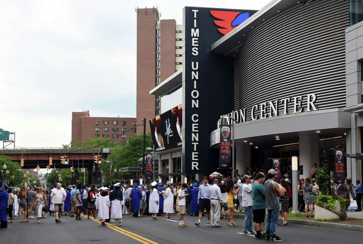 Graduates meet with friends and family outside of the arena during Shaker High's 61st Commencement Ceremony on Saturday, June 29, 2019 at Times Union Center in Albany, NY. (Phoebe Sheehan/Times Union)