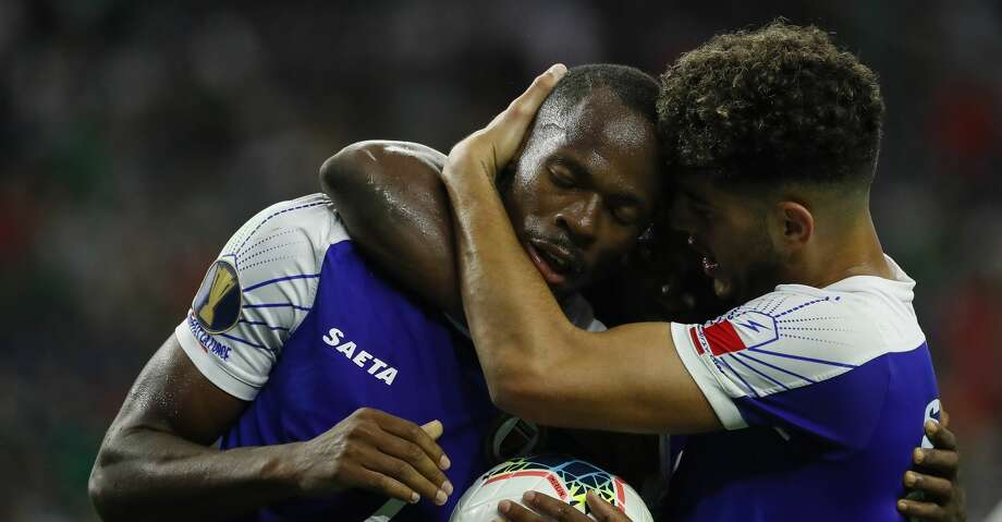 Haiti forward Herve Bazile (7) is hugged by teammates after getting a penalty call in his favor against Canada during the second half of a CONCACAF Gold Cup quarterfinals match at NRG Stadium Saturday, June 29, 2019, in Houston. Haiti won 3-2. Photo: Godofredo A Vásquez/Staff Photographer