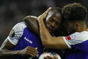 Haiti forward Herve Bazile (7) is hugged by teammates after getting a penalty call in his favor against Canada during the second half of a CONCACAF Gold Cup quarterfinals match at NRG Stadium Saturday, June 29, 2019, in Houston. Haiti won 3-2.
