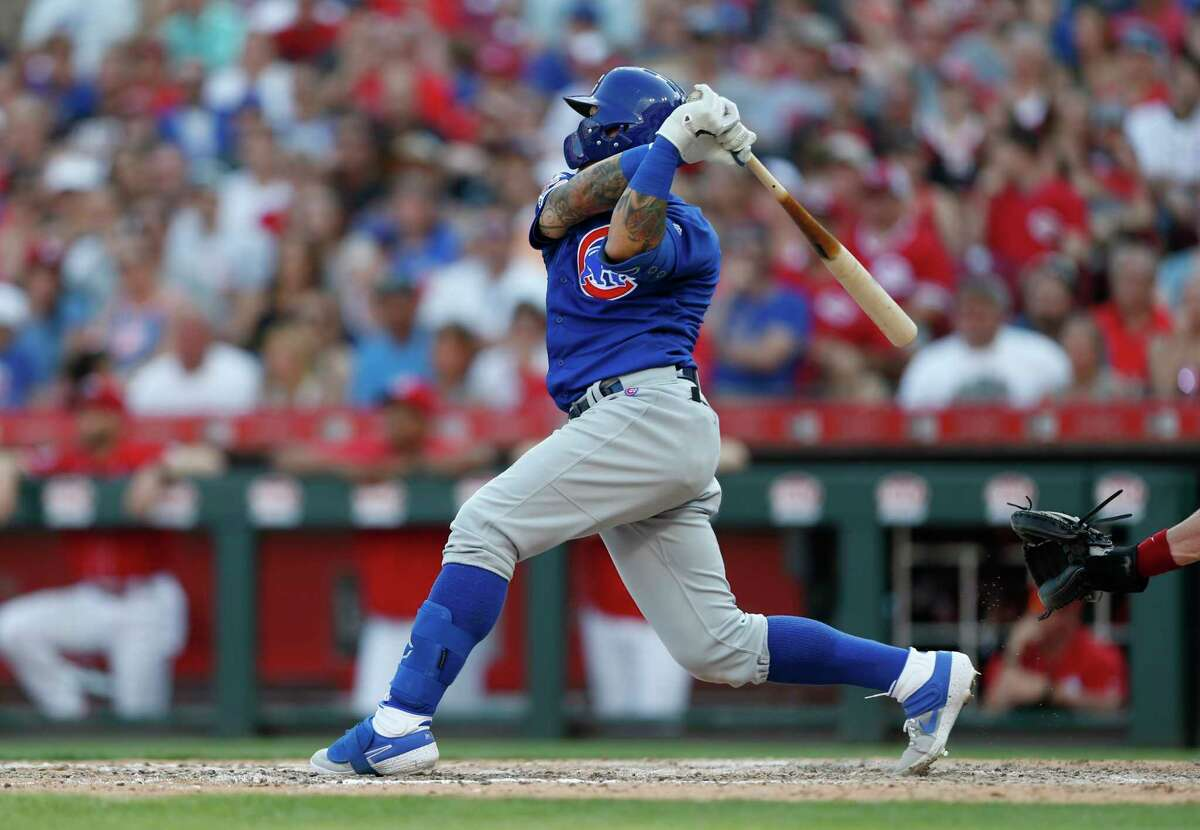 Chicago Cubs' Javier Baez follows through on a grand slam home run during the eighth inning of a baseball game, Saturday, June 29, 2019, in Cincinnati. (AP Photo/Gary Landers)