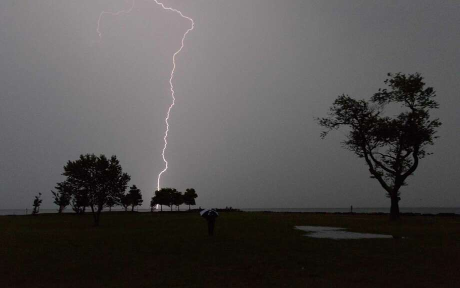 FILE PHOTO — A bolt of lighting strikes at Sherwood Island State Park in Westport, Conn. Photo: Matthew Brown / Hearst Connecticut Media / Stamford Advocate