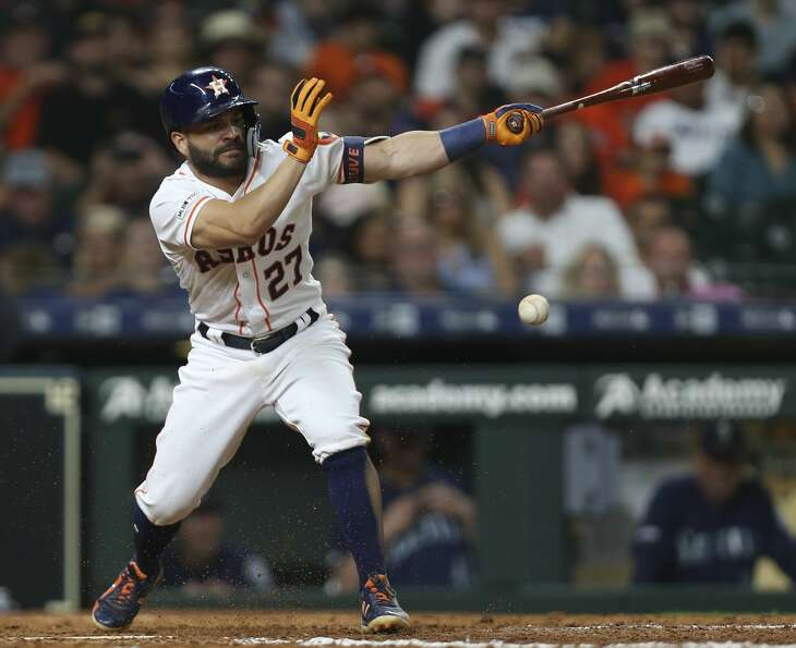 Houston Astros second baseman Jose Altuve (27) groudns out during bottom ninth inning of the MLB game against the Seattle Mariners at Minute Maid Park on Saturday, June 29, 2019, in Houston.
