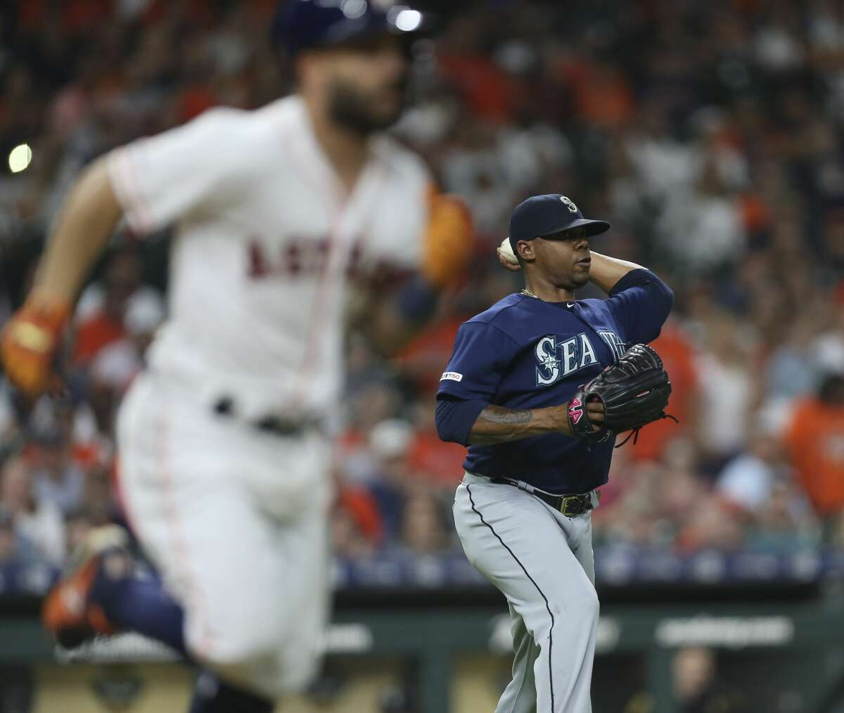 Houston Astros second baseman Jose Altuve (27) grounds out to Seattle Mariners starting pitcher Roenis Elias (55) during bottom ninth inning of the MLB game at Minute Maid Park on Saturday, June 29, 2019, in Houston.
