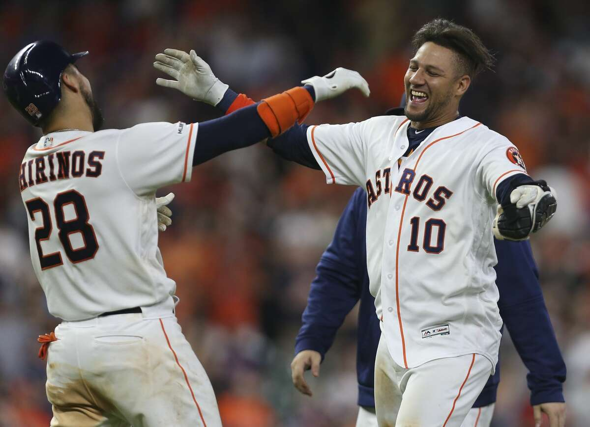 Houston Astros first baseman Yuli Gurriel (10) celebrates with Robinson Chirinos (28) as his walk-off double helped the Astros defeat the Seattle Mariners 6-5 during bottom tenth inning of the MLB game at Minute Maid Park on Saturday, June 29, 2019, in Houston. Gurriel had helped the team to win in a walk-off style two nights in a row.