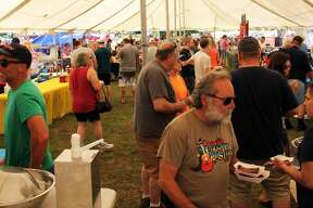 Cooks compete to see who can smoke the best ribs during the second day of the Ribstock Festival in Caseville. Scotty's Smokehouse won the people's choice vote, while the judges chose BK's Burgers/Kretzschy's Smokey BBQ as the winner.
