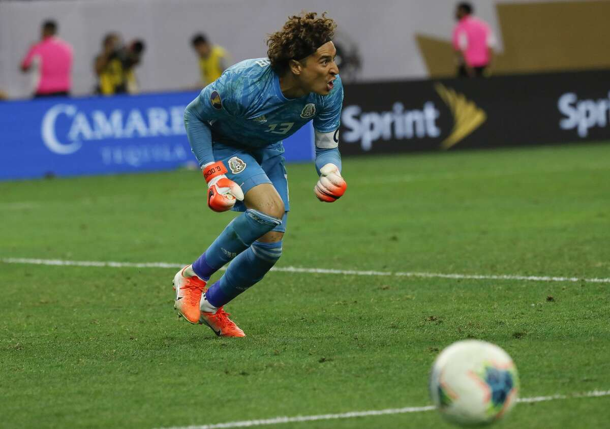 Mexico goalkeeper Guillermo Ochoa (13) celebrates after making the game winning save against Costa Rica during penalty-kick shootouts in a CONCACAF Gold Cup quarterfinals match at NRG Stadium Saturday, June 29, 2019, in Houston.
