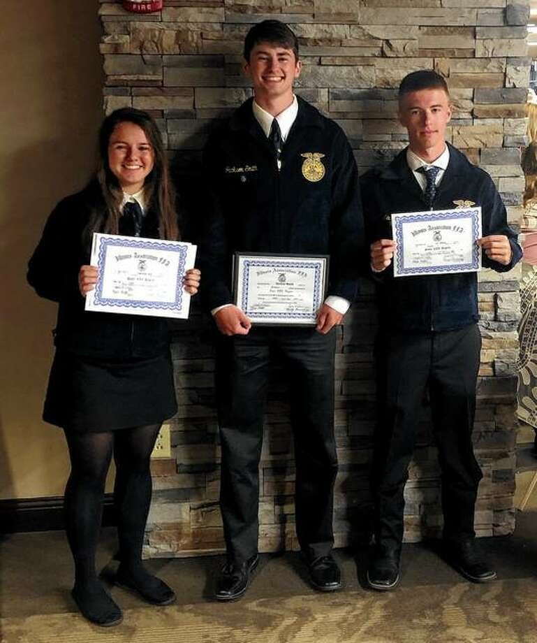 Franklin FFA members Samantha Mies (from left), Jackson Smith and Levi Brown recently attended the 91st annual Illinois State FFA Convention, where they received their Illinois State FFA degree. Photo: Photo Provided