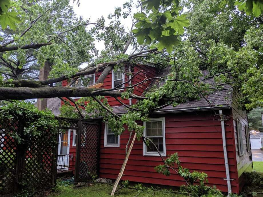 A large tree fell on a Westport home during thunderstorms that hit on Saturday, June 29, 2019. Photo: Contributed Photo/Wesport Fire Department Facebook / Contributed / The News-Times Contributed