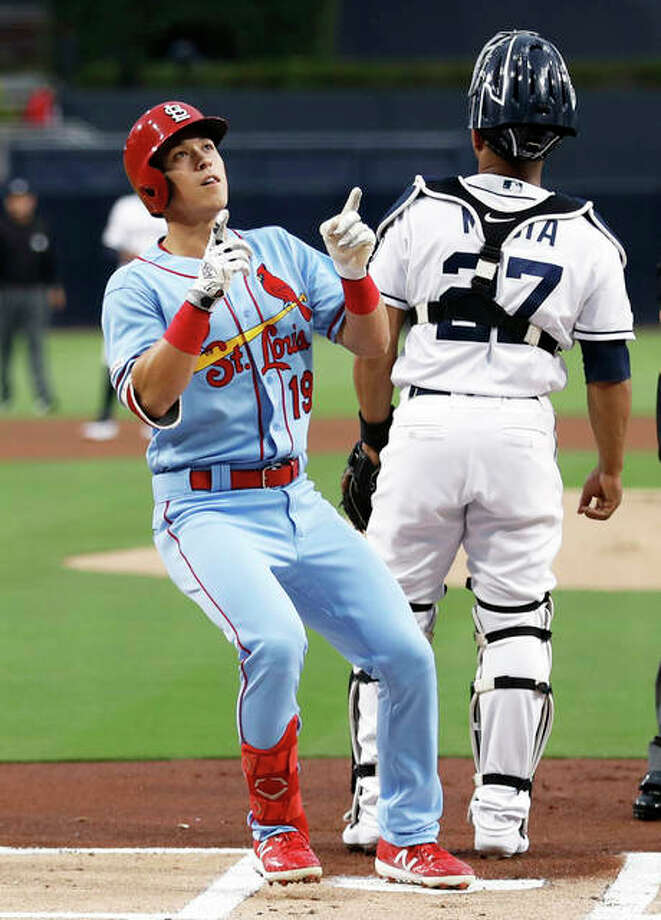 Cardinals rookie Tommy Edman (left) gestures to some fans after hitting a home run to lead off Saturday night's game as Padres catcher Francisco Mejia looks to the field in San Diego. That 1-0 lead would not last in the Cardinals' 12-2 defeat. Photo: Associated Press