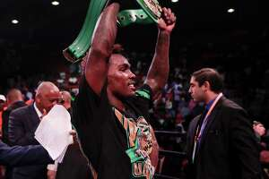 HOUSTON, TX - JUNE 29:  Jermall Charlo celebrates with his championship belt after defeating Brandon Adams during the WBC World Middleweight Championship at NRG Arena on June 29, 2019 in Houston, Texas.