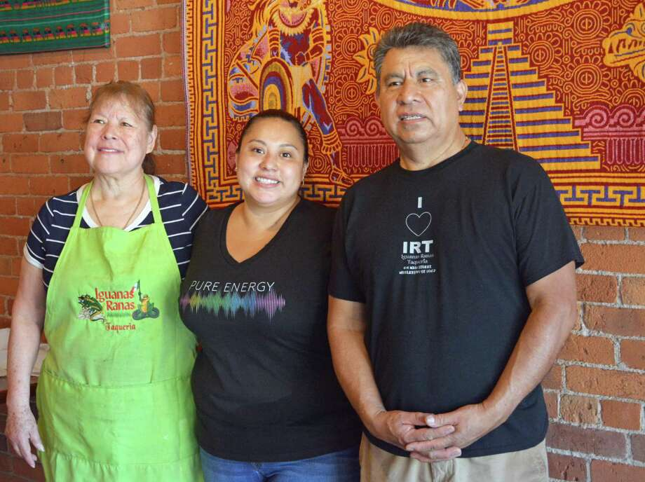 Iguanas Ranas Taqueria owners Angela Martinez, left, and Hipolito Martinez, right, stand with daughter Martha Martinez Thursday morning at the 484 Main St., Middletown, restaurant. The family opened the eatery in 2008 and made the difficult decision recently to close July 3. Photo: Cassandra Day / Hearst Connecticut Media