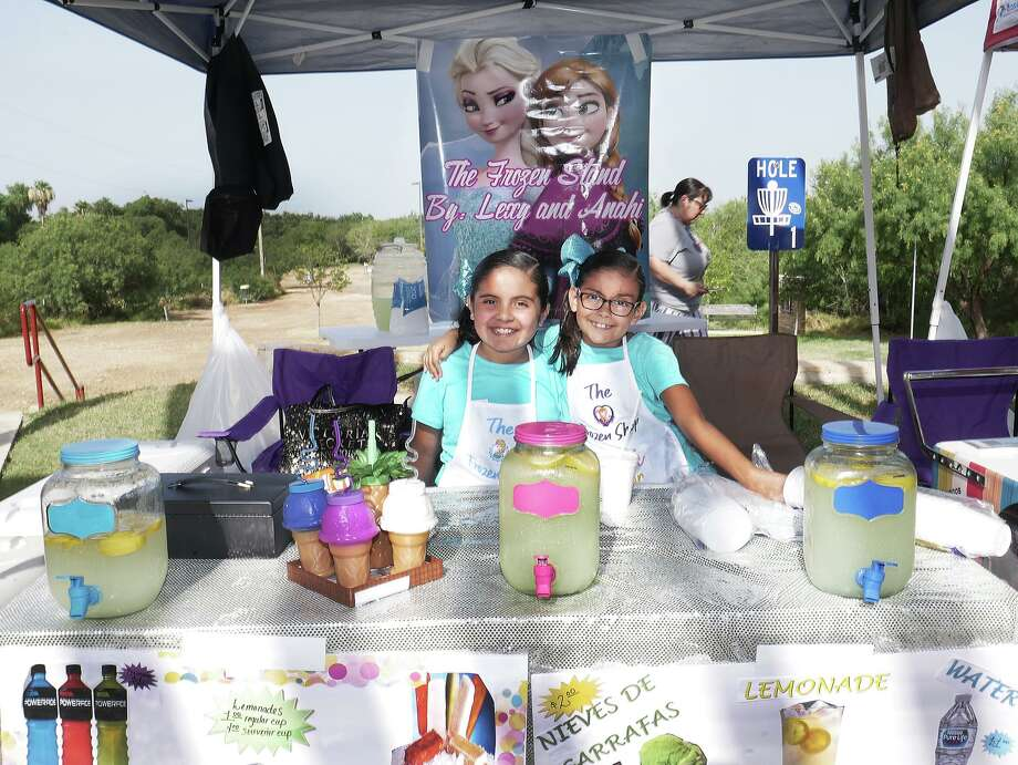 "Lexi and Anahi Martinez participated in the first Laredo Kids Fair running ""The Frozen Stand"" Saturday at North Central Park. Photo: Cuate Santos /Laredo Morning Times / Laredo Morning Times"