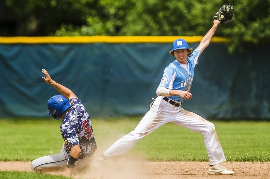 Gladwin Post 171's Justin Greer slides into second base during a game against Bay City in the Gabby Mills Invitational on Sunday, June 30, 2019 at Midland High School. (Katy Kildee/kkildee@mdn.net) Photo: (Katy Kildee/kkildee@mdn.net)