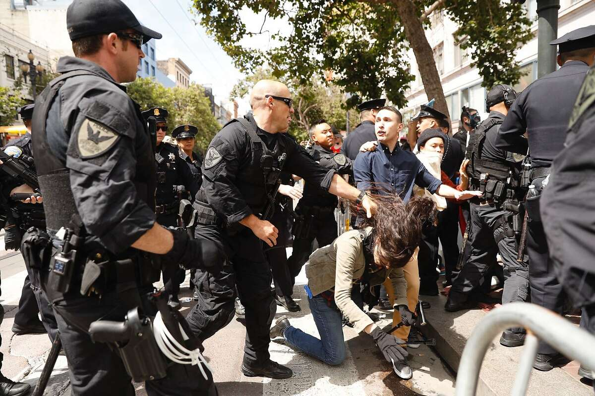 Police move in to break up a group of protesters that blocked Market Street at the Gay Pride Parade. The group brought the parade to a standstill at mid-day Sunday, June 30, 2019.