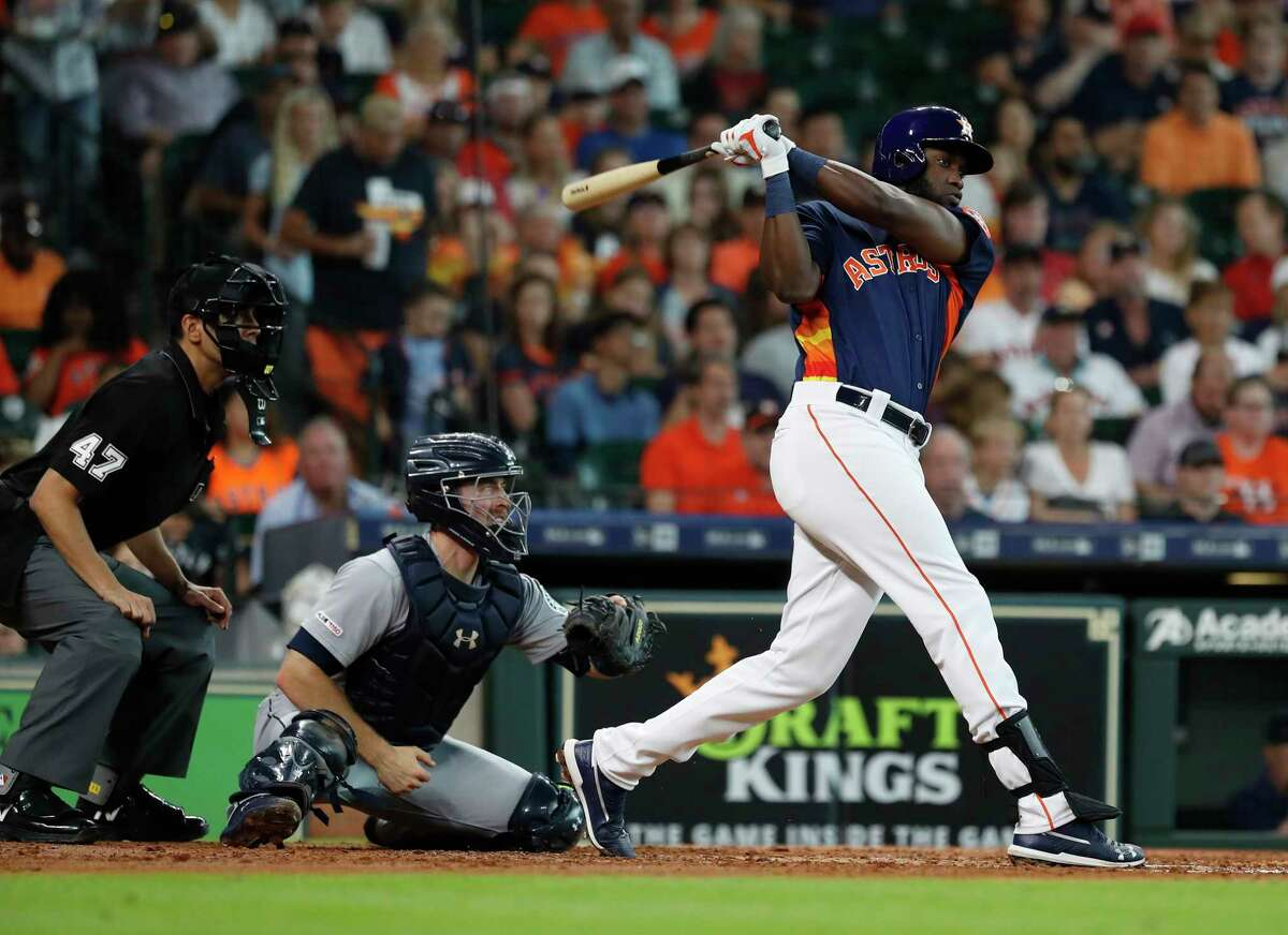 Houston Astros designated hitter Yordan Alvarez (44) hits a single during the third inning of an MLB baseball game at Minute Maid Park, Saturday, June 30, 2019, in Houston.