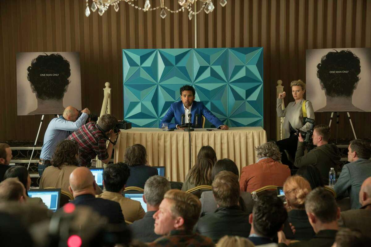 This image released by Universal Pictures shows Himesh Patel and Kate McKinnon, right, in a scene from