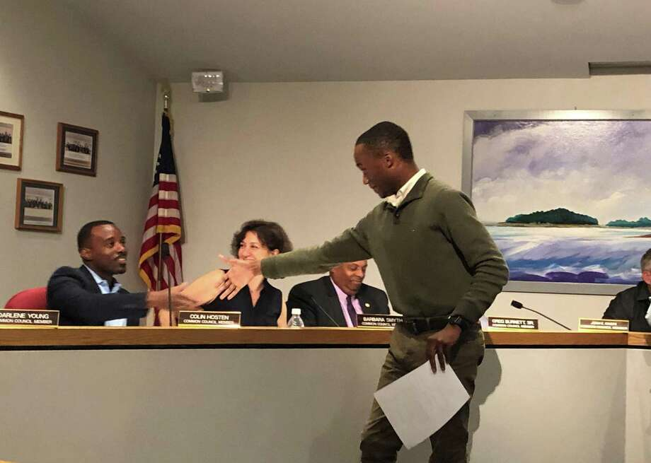 Darius Williams, a newly appointed member of the Oak Hills Park Authority, shakes hands with Common Council members on Tuesday, June 25, 2019. Photo: Kelly Kultys / Hearst Connecticut Media