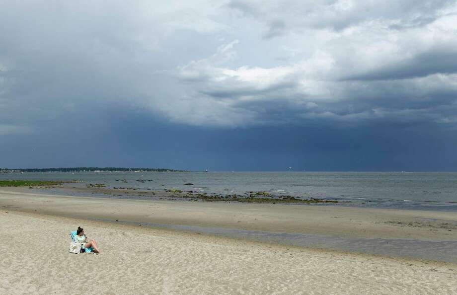 Greenwich's Marley Macdougall is the first one back on the sand after a brief storm that cleared the beach at Greenwich Point Park in Old Greenwich, Conn. Sunday, June 30, 2019. Photo: Tyler Sizemore, Hearst Connecticut Media / Greenwich Time