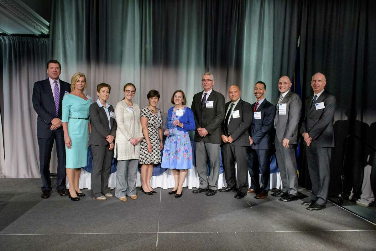 Members of the Norwalk Hospital Joint Replacement Center and also Norwalk Hospital senior leadership at Connecticut Hospital Association Annual Meeting Awards Ceremony in June 20, 2019. The Norwalk Hospital Joint Replacement Center won this year's highest quality award from the CHA: The John D. Thompson award for excellence in the delivery of healthcare through the use of data. From left, Dr. John Murphy, Deborah Canet, Leslie Lincoln, Laura Fratarcangeli, Anne Newton, MaryAlice Morton, Dr. Nicholas Polifroni, Carey Villafranca, Virgil Sosa, Peter Cordeau, Robert Friedberg