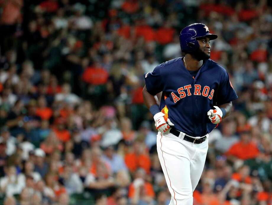 Houston Astros designated hitter Yordan Alvarez (44) smiles at Seattle Mariners Mike Wright Jr.  as he was intentionally walked during the seventh inning of an MLB baseball game at Minute Maid Park, Sunday, June 30, 2019, in Houston. Photo: Karen Warren, Staff Photographer / © 2019 Houston Chronicle
