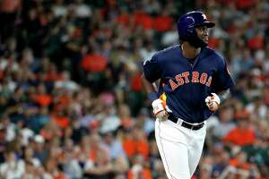 Houston Astros designated hitter Yordan Alvarez (44) smiles at Seattle Mariners Mike Wright Jr.  as he was intentionally walked during the seventh inning of an MLB baseball game at Minute Maid Park, Saturday, June 30, 2019, in Houston.