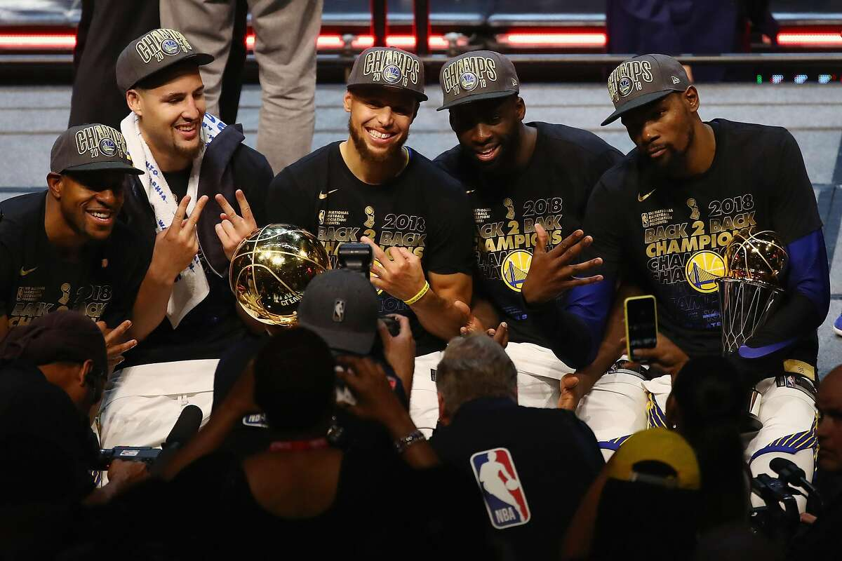 CLEVELAND, OH - JUNE 08: Andre Iguodala #9, Klay Thompson #11, Stephen Curry #30, Draymond Green #23 and Kevin Durant #35 of the Golden State Warriors celebrate after defeating the Cleveland Cavaliers during Game Four of the 2018 NBA Finals at Quicken Lo