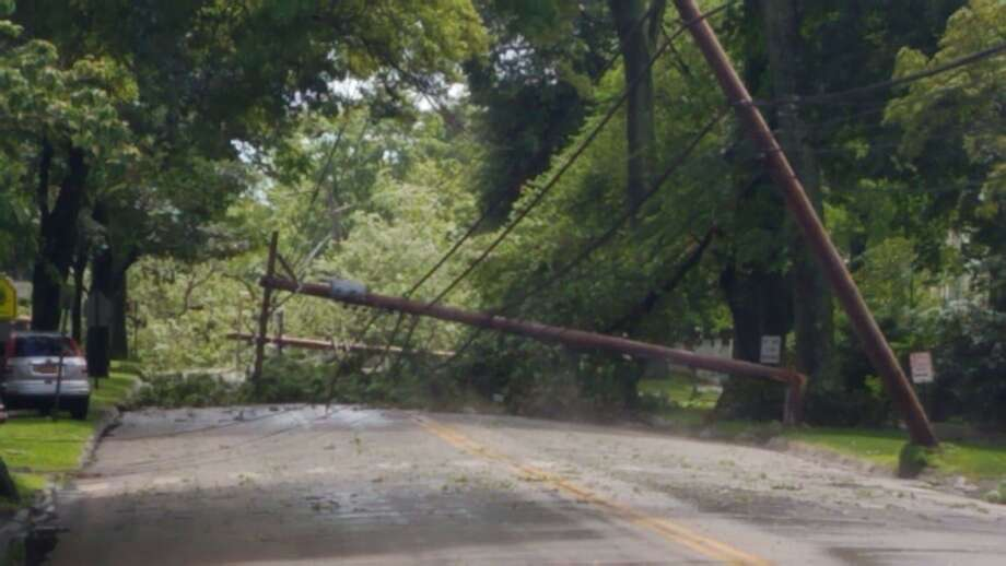 Fairfield police were reporting multiple downed lines and outages around town on June 30, 2019, due to a string of thunder storms. Police also reported that a man died when a tree limb fell on his car that day. Photo: Contributed / Fairfield Police Department
