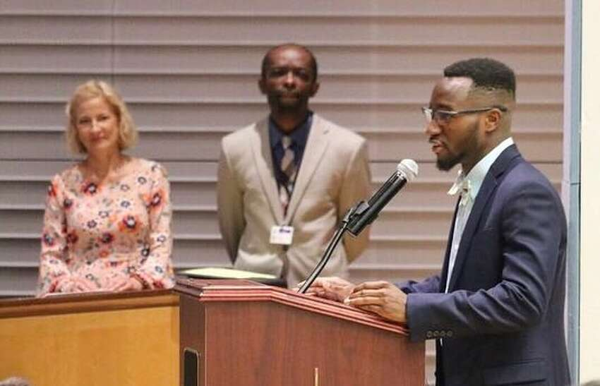 Musa Kanneh speaks at the graduation of his alma mater, Stephen and Harriet Myers Middle School, 14 years after he was resettled as a refugee, in Albany, N.Y. on June 26, 2019.
